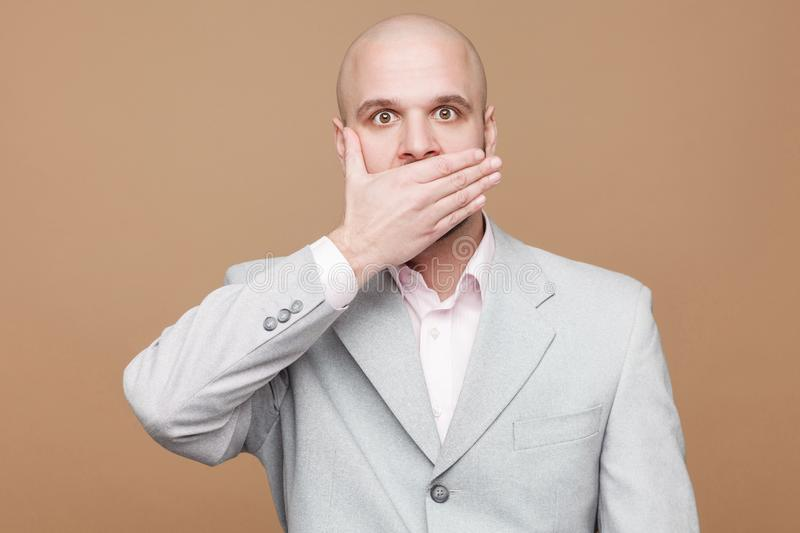 I`m will be quiet. Portrait of shocked handsome middle aged bald royalty free stock image