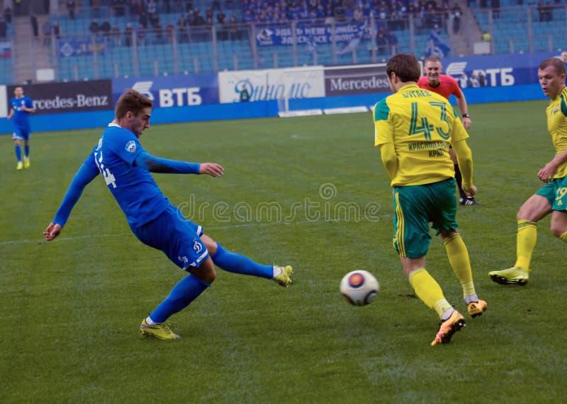 I Markelov ( 14) dribble stock foto