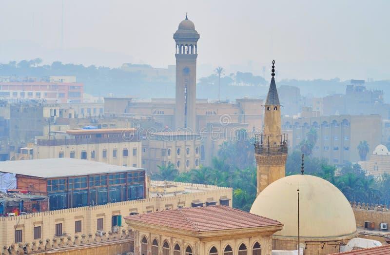I minareti in nebbia, Il Cairo, Egitto fotografia stock