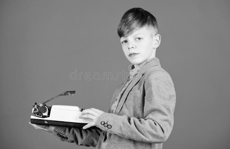 I need modern gadget instead this retro. Outdated gadget. Retro and vintage. Yard sale. Retrospective study. Boy hold. Retro typewriter on blue background. What stock image