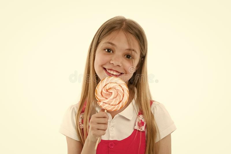 I need treat. Girl cute smiling face holds sweet lollipop. Sweets in appropriate portions ok. Girl likes sweets as. Lollipop candy, isolated white background stock photos
