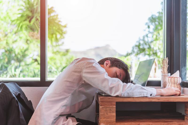 I need a vacation! Close up top view portrait of tired sick young. He is wearing the formalwear, resting at the workplace royalty free stock photos