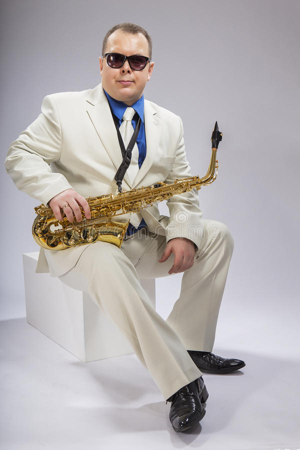 I och saxofon royaltyfri foto