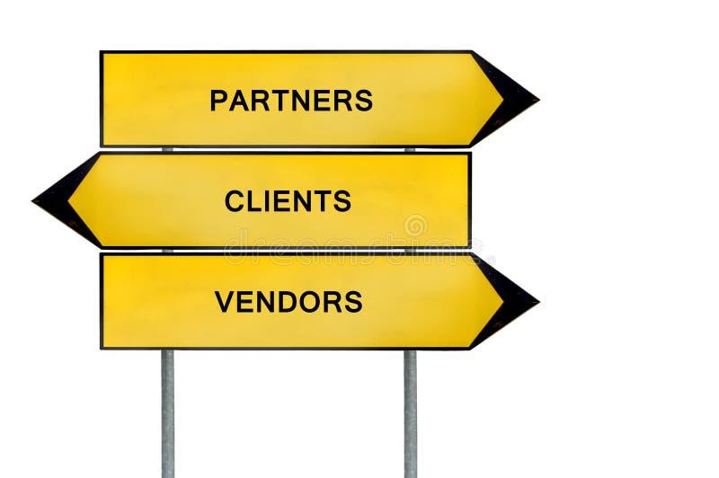 I partner, i venditori ed i clienti gialli di concetto della via firmano fotografia stock