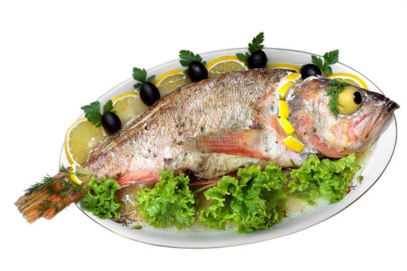I pesci cotti hanno isolato fotografie stock libere da diritti