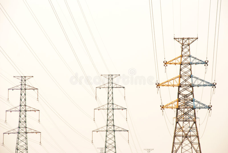 I piloni di elettricità fotografia stock libera da diritti