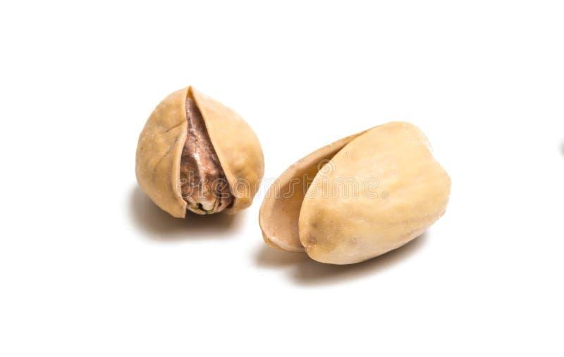 i pistacchi hanno isolato la o fotografie stock