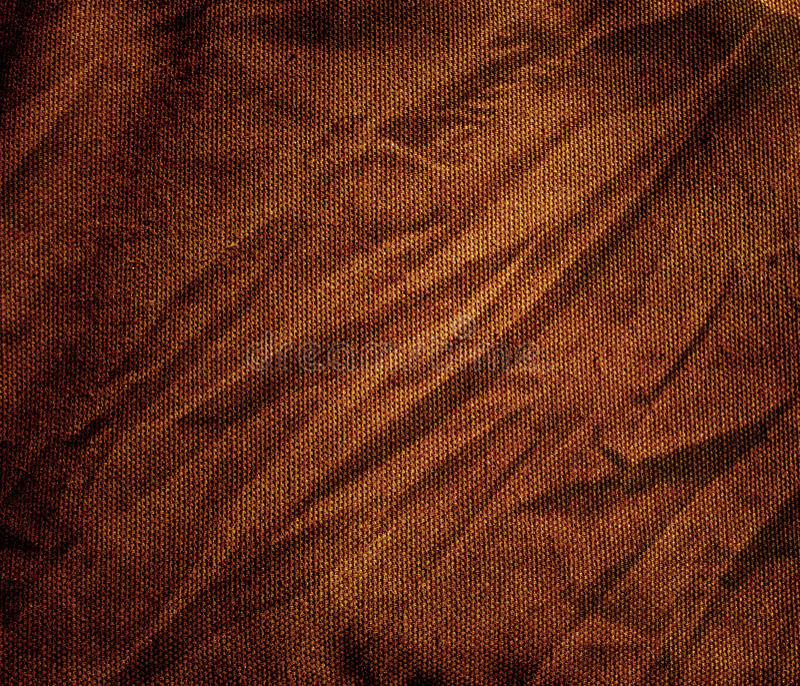 I precedenti marroni sgualciti del tessuto della tela fotografie stock