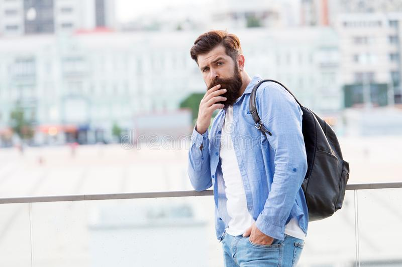 I prefer active vacation. Hipster on vacation travel. Bearded man travelling with backpack on summer vacation. Backpacker going on vacation. Tourist or stock photography