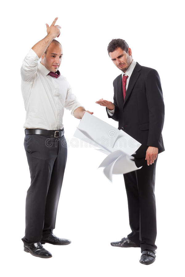 I Quit!. A businessman throwing paperwork an quitting the job in front of his boss stock photo