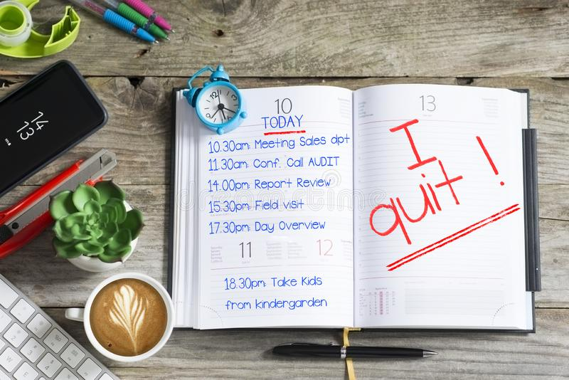 I quit, text written by stressed employee on personal agenda after a hard day royalty free stock photography