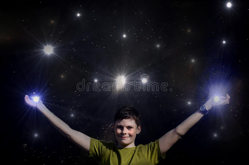 I reach the sky. Teenager boy tries to catch the stars