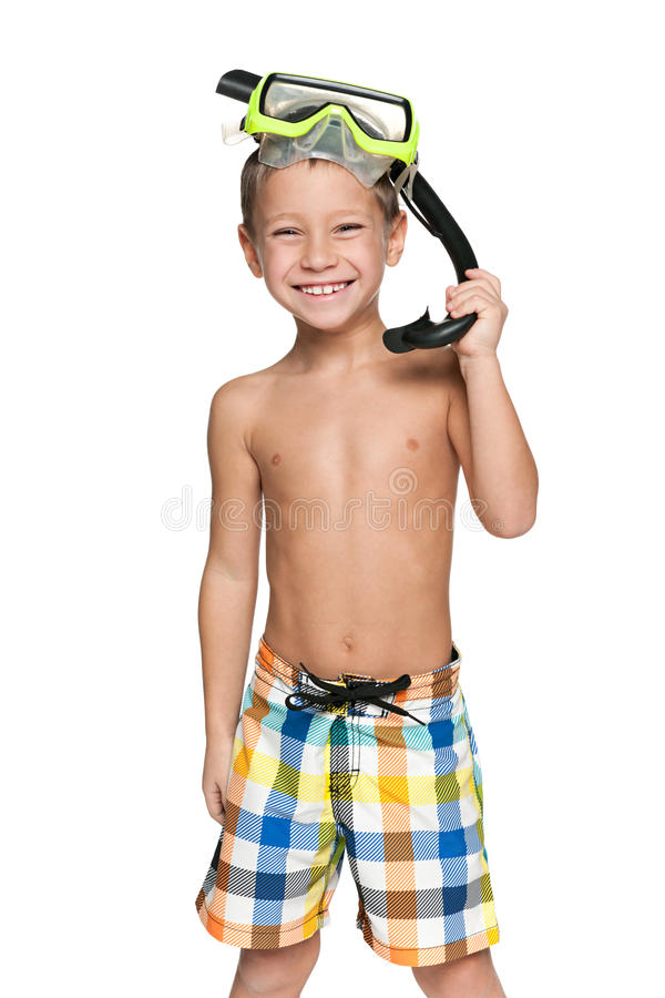 I am ready for snorkeling!. A portrait of a joyful boy getting ready for snorkeling royalty free stock image