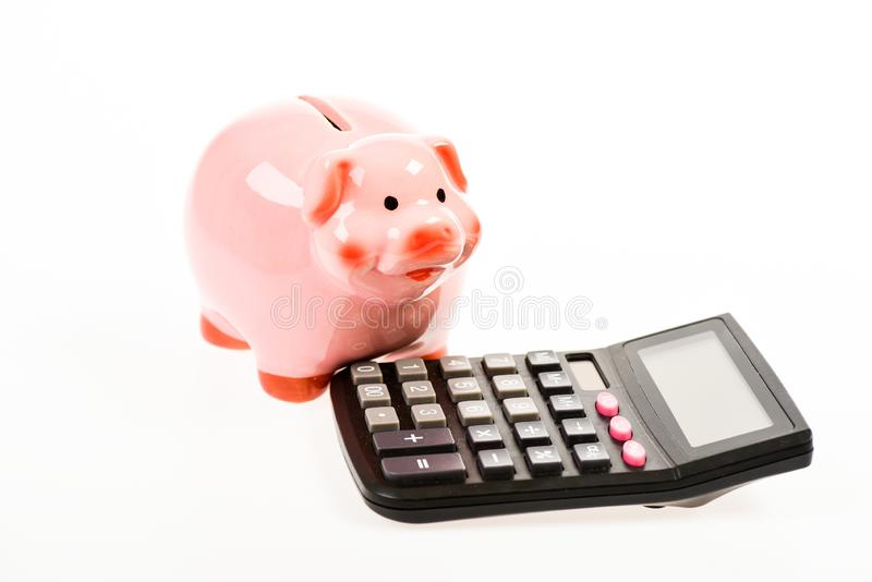 I am rich. moneybox with calculator. Piggy bank. bookkeeping or counting house. financial problem. planning and counting stock images
