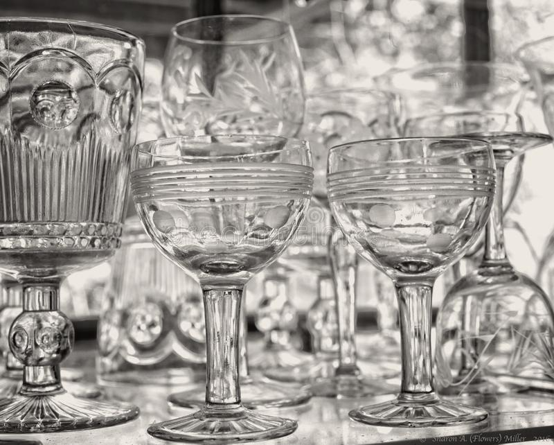Glassware on glass shelves in glass window royalty free stock photo