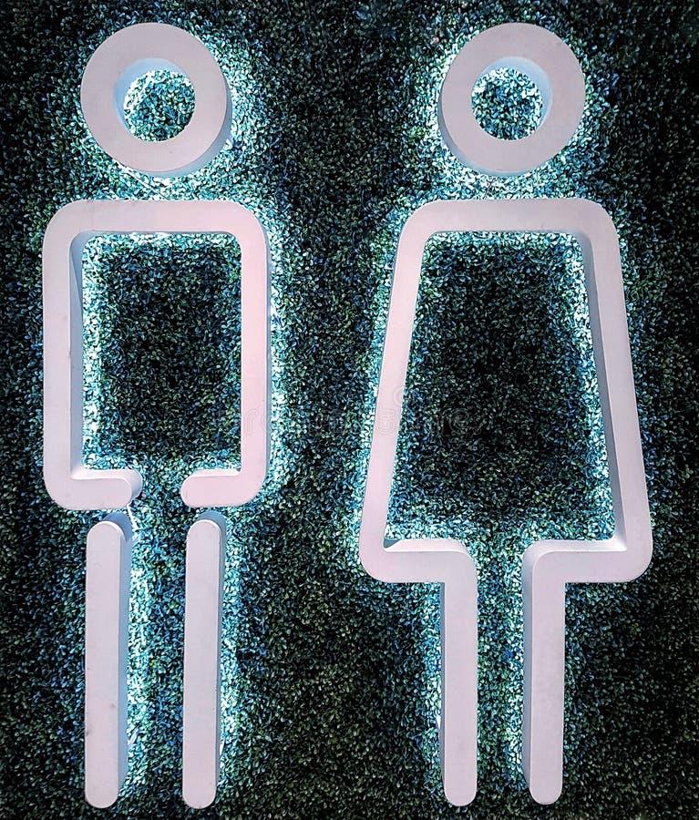 I simboli della toilette per gli uomini e le donne fotografia stock