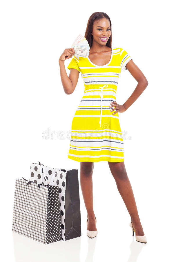 I soldi africani della donna spendono immagine stock