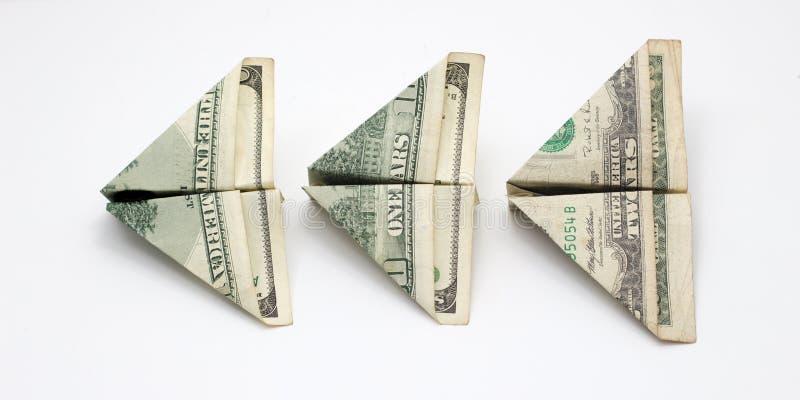 I soldi di volo pagano fuori il concetto su fondo bianco fotografie stock
