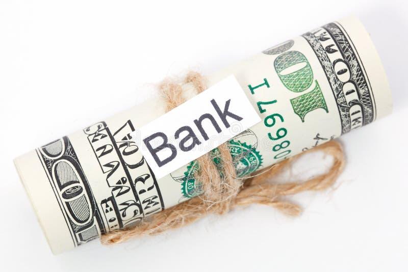 I soldi e l'idea di affari, le banconote in dollari hanno legato con una corda, con un segno - la Banca fotografie stock