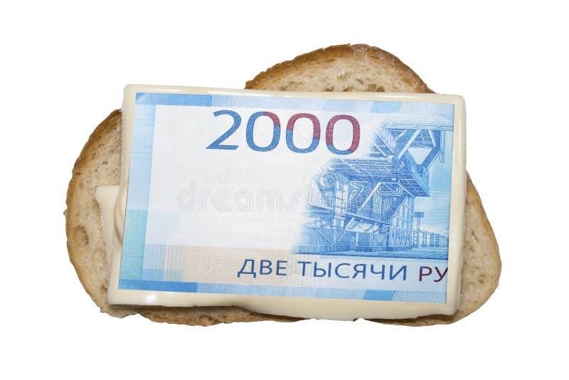I soldi sono spanti su pane fotografie stock libere da diritti