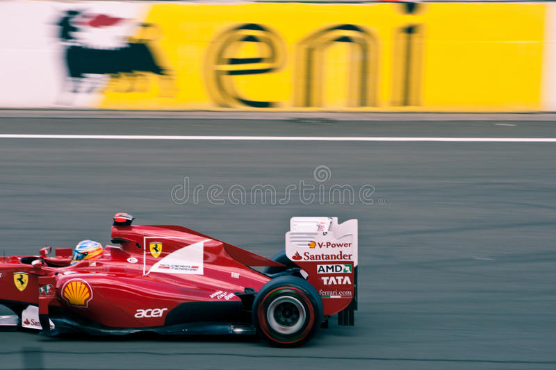 I am too fast for your puny camera!. Image showing a Ferrari F1 car racing on the Hungaroring circuit at the 2011 Hungarian Grand Prix
