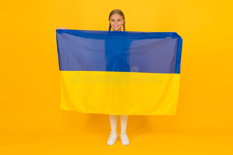 I am ukrainian and proud of it. Patriotic education. Happy independence day. Kid hold ukrainian flag. Patriotism love stock images