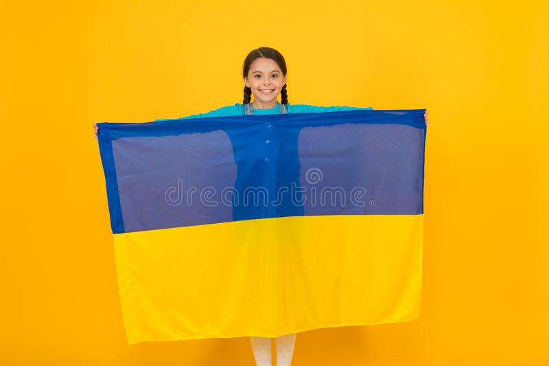 I am ukrainian and proud of it. Patriotism love Ukraine motherland. National identity. Girl with blue and yellow. Ukrainian flag. Patriotic education. Happy royalty free stock photos