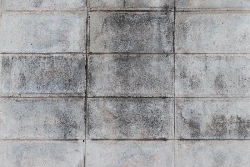 I vecchi precedenti grigi della parete del blocco in calcestruzzo fotografia stock