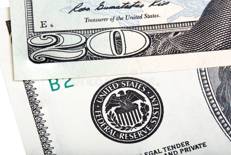 I venti dollari di banconota della fattura vicino alla guarnizione di Federal Reserve immagini stock