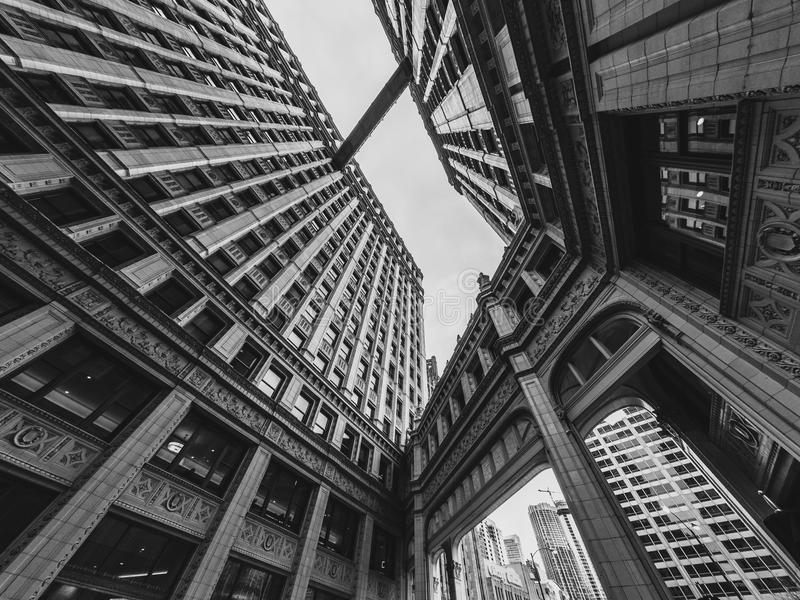 I walk the skywalk in Chicago. Upward view between the building towers in Chicago royalty free stock photo