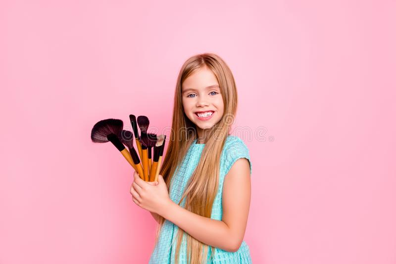 I want to be a make up artist! Cute charming sweet lovely delightful small girl with long straight blonde hair wearing blue dress stock photos
