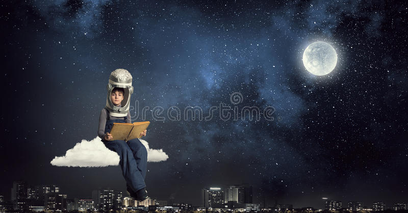 I will explore space . Mixed media. Cute kid boy with carton helmet on head dreaming to become astronaut stock image