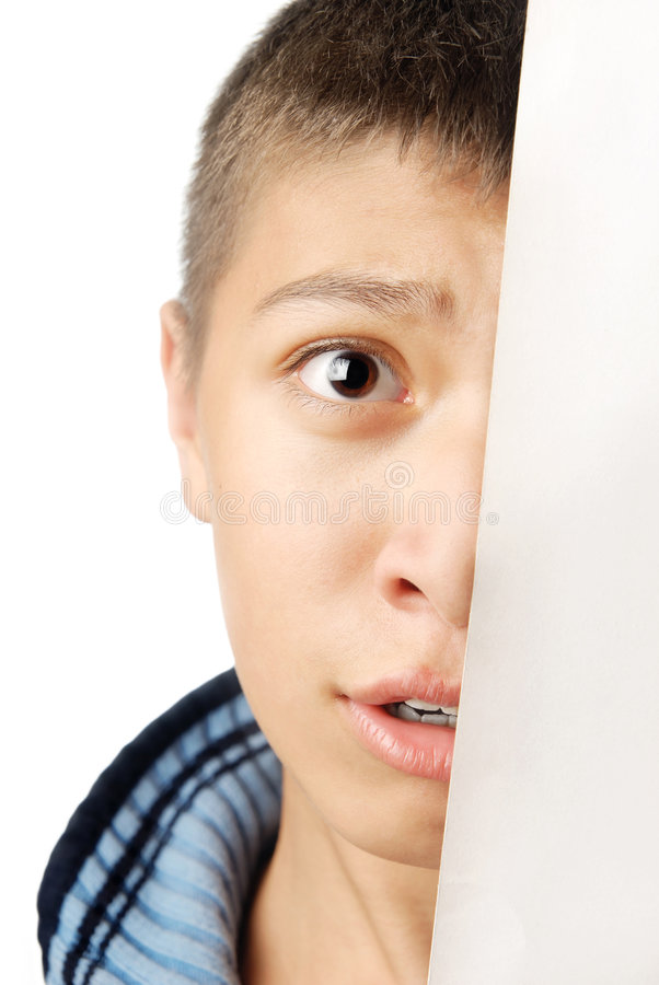 I will hide from you. Hiding boy with fear expression on his face stock image