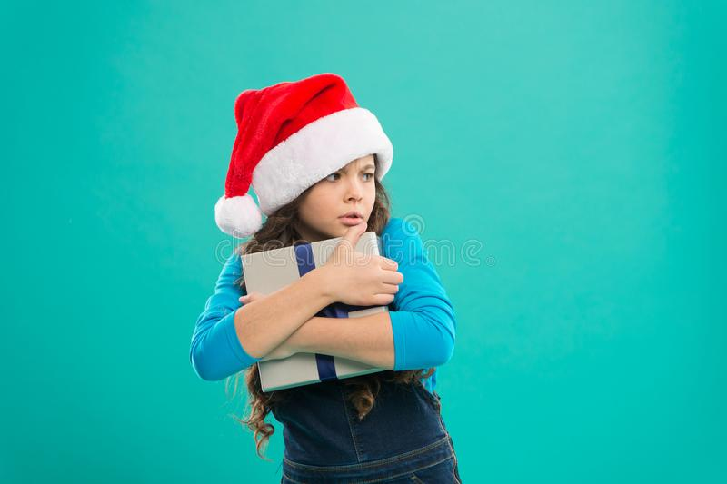 I will not give it to anyone. Shopping online. Winter sale. Child hug gift. Happy new year. All about sharing and caring. Packaging for gift. Small girl hold royalty free stock photo
