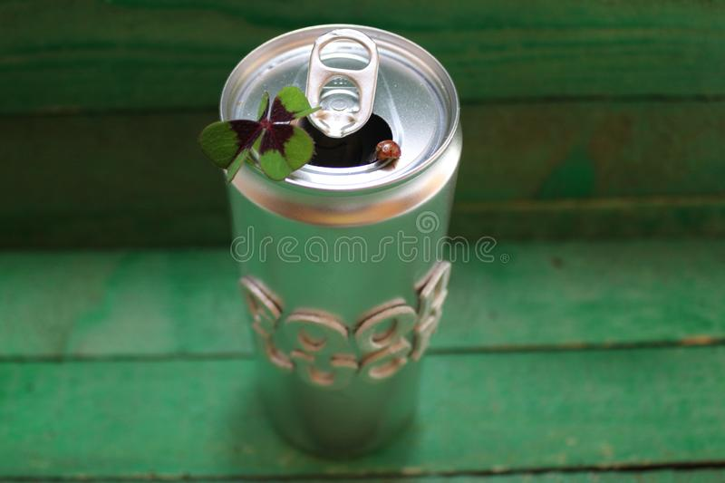 I wish you the best of luck !. The picture shows a silver can with a lucky clover and a ladybird stock photo