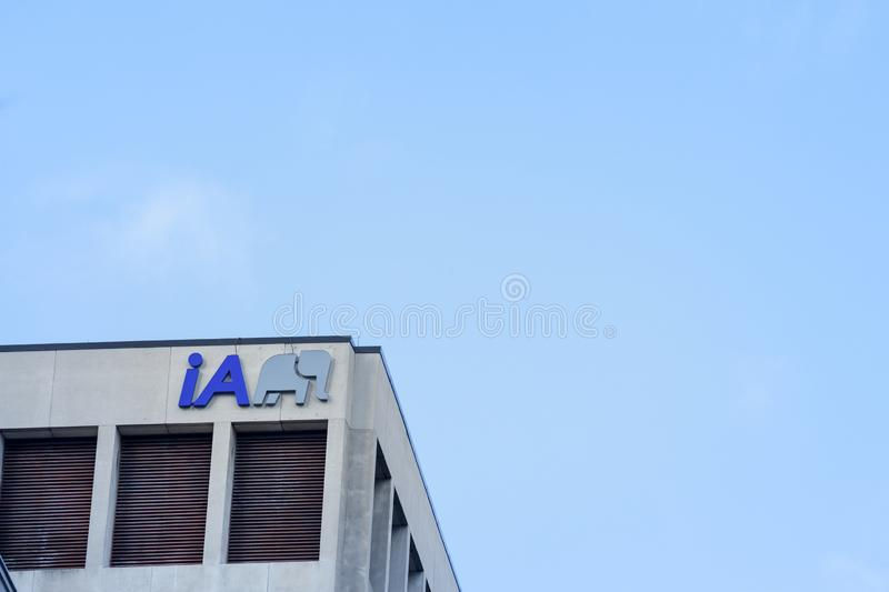 IA Insurance logo in front of their main office for Toronto, Ontario. TORONTO CANADA - NOVEMBER 14, 2018: Industrial Alliance is one of the main Canadian stock photography