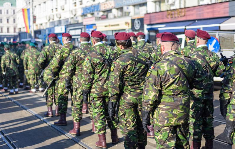 Soldiers in military green uniform marching and celebrating stock image
