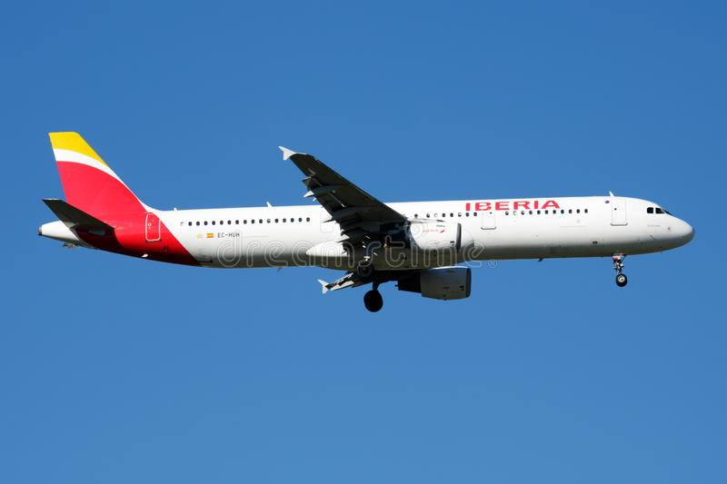 Iberia Airlines Airbus A321 EC-HUH passenger plane landing at Madrid Barajas Airport. MADRID / SPAIN - MAY 2, 2016: Iberia Airlines Airbus A321 EC-HUH passenger royalty free stock photography