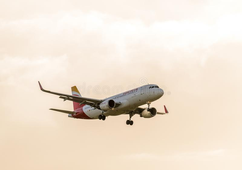 Iberia Airways jet landing at Heathrow. October 2017 landing Gear down royalty free stock photo
