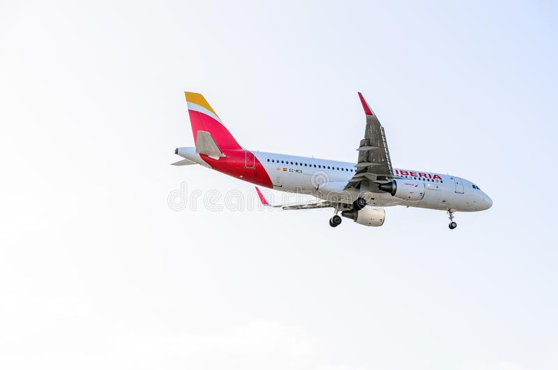 Iberia Airways jet landing at Heathrow. October 2017 landing Gear down royalty free stock photos