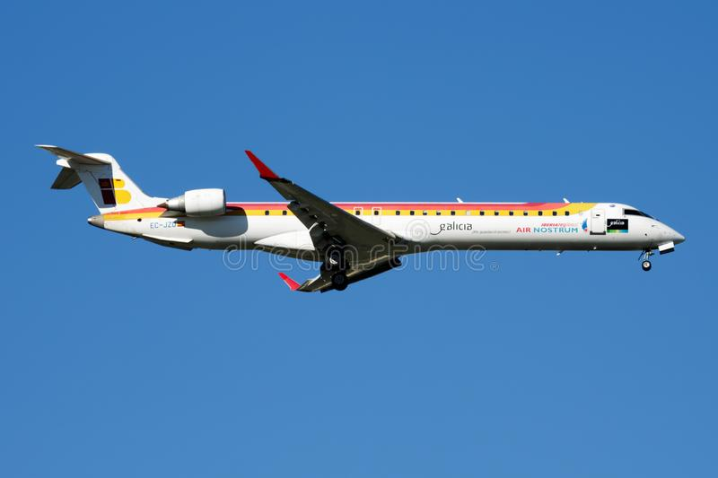 Iberia Regional Air Nostrum Bombardier CRJ-900 EC-JZU passenger plane landing at Madrid Barajas Airport. MADRID / SPAIN - MAY 2, 2016: Iberia Regional Air stock photo