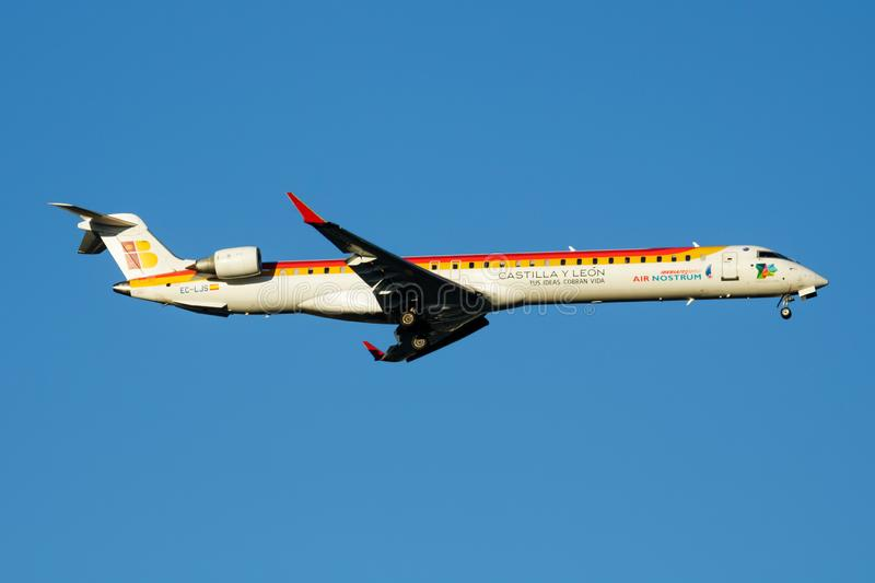 Iberia Regional Air Nostrum Bombardier CRJ-1000 EC-LJS passenger plane landing at Madrid Barajas Airport. MADRID / SPAIN - MAY 2, 2016: Iberia Regional Air stock images