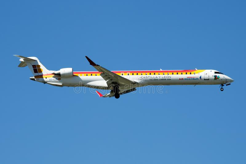 Iberia Regional Air Nostrum Bombardier CRJ-1000 EC-LJS passenger plane landing at Madrid Barajas Airport. MADRID / SPAIN - MAY 2, 2016: Iberia Regional Air royalty free stock photography