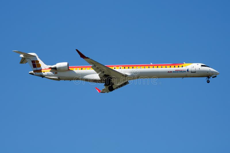 Iberia Regional Air Nostrum Bombardier CRJ-1000 EC-LJT passenger plane landing at Madrid Barajas Airport. MADRID / SPAIN - MAY 2, 2016: Iberia Regional Air royalty free stock photography