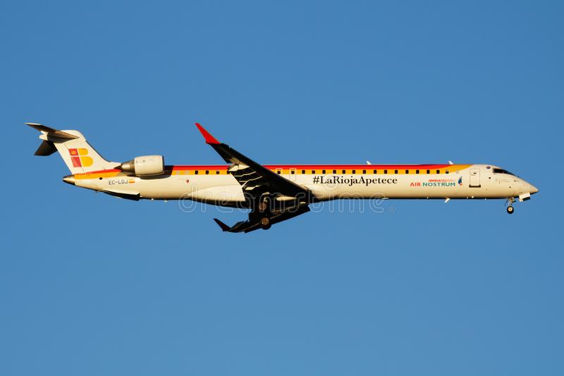 Iberia Regional Air Nostrum Bombardier CRJ-1000 EC-LOI passenger plane landing at Madrid Barajas Airport. MADRID / SPAIN - MAY 2, 2016: Iberia Regional Air royalty free stock photography