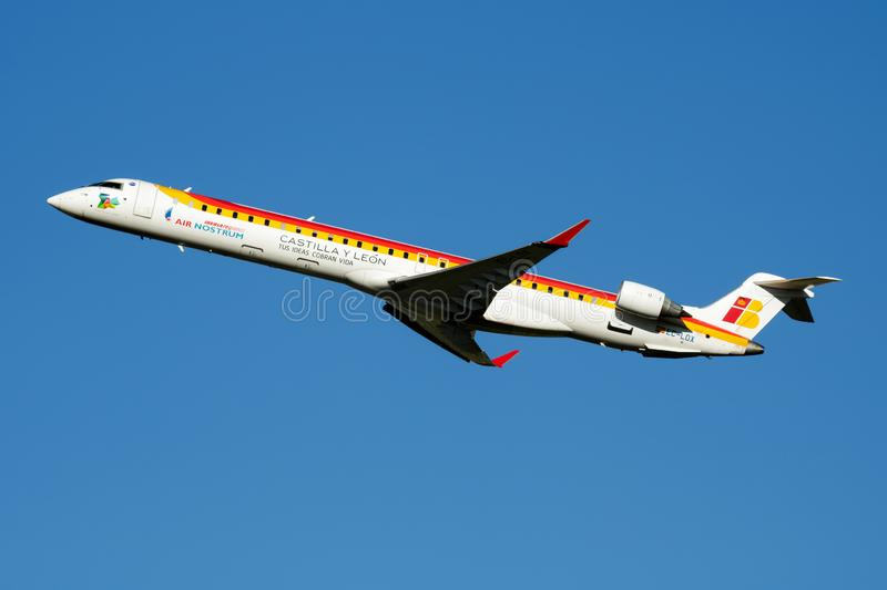 Iberia Regional Air Nostrum Bombardier CRJ-1000 EC-LOX passenger plane departure at Madrid Barajas Airport. MADRID / SPAIN - MAY 1, 2016: Iberia Regional Air stock image