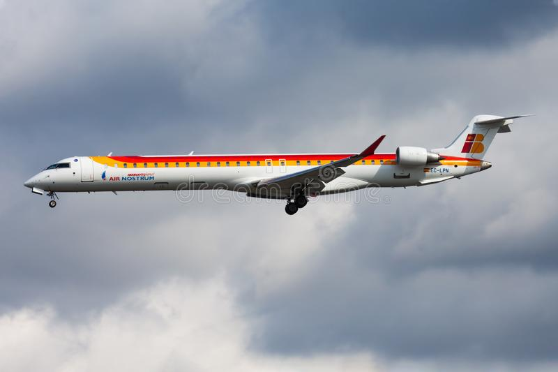 Iberia Regional Air Nostrum Bombardier CRJ-1000 EC-LPN passenger plane landing at Frankfurt airport. FRANKFURT / GERMANY - AUGUST 12, 2014: Iberia Regional Air royalty free stock photography