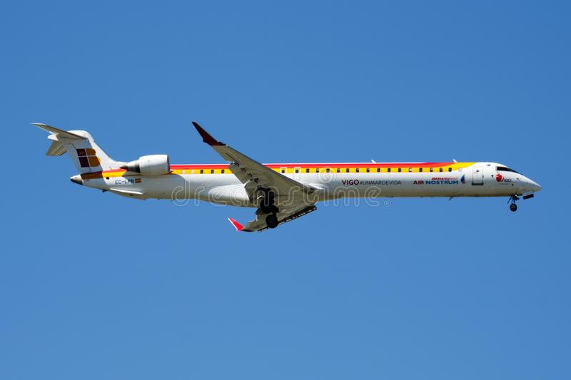 Iberia Regional Air Nostrum Bombardier CRJ-1000 EC-LPN passenger plane landing at Madrid Barajas Airport. MADRID / SPAIN - MAY 2, 2016: Iberia Regional Air royalty free stock photography