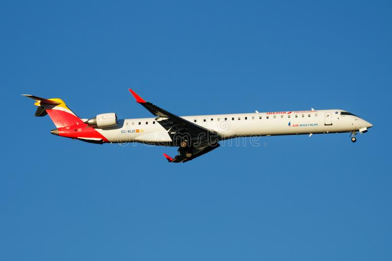 Iberia Regional Air Nostrum Bombardier CRJ-1000 EC-MJO passenger plane landing at Madrid Barajas Airport. MADRID / SPAIN - MAY 2, 2016: Iberia Regional Air stock photo