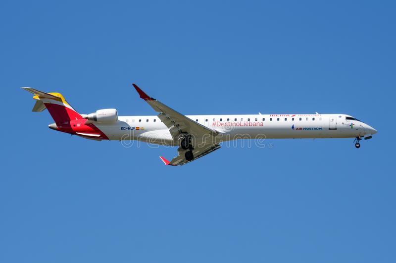 Iberia Regional Air Nostrum Bombardier CRJ-1000 EC-MJP passenger plane landing at Madrid Barajas Airport. MADRID / SPAIN - MAY 2, 2016: Iberia Regional Air stock photo